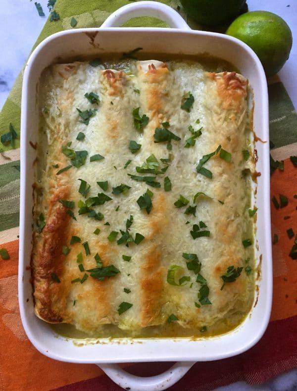 Turkey Enchiladas in a white baking dish.