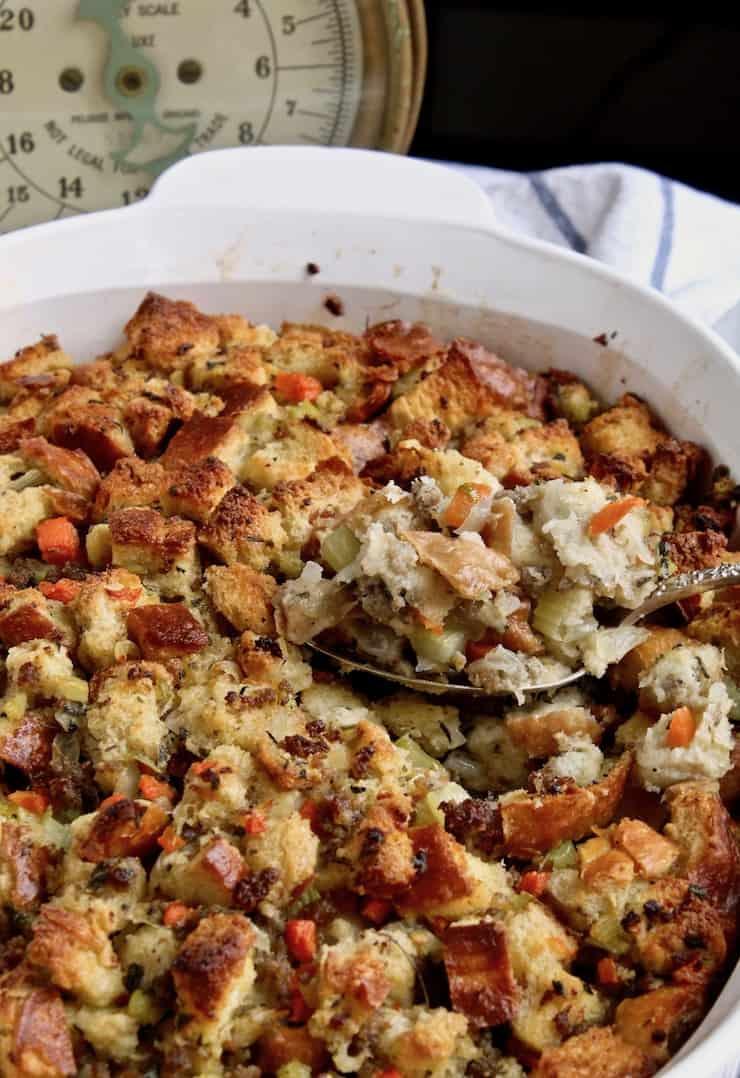 Old fashioned bread stuffing in a white baking dish.