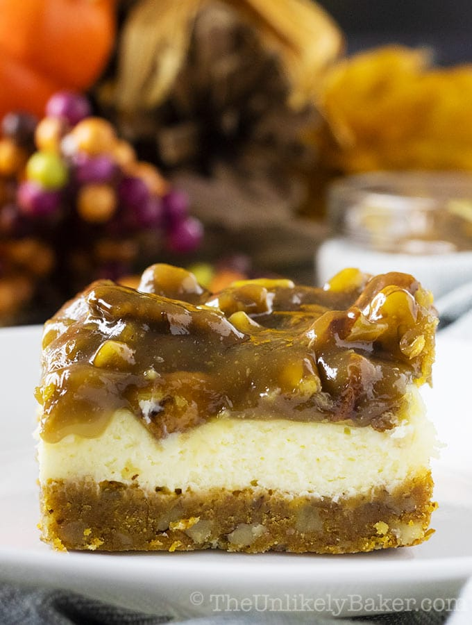 Pecan pie cheesecake bar on a white plate.