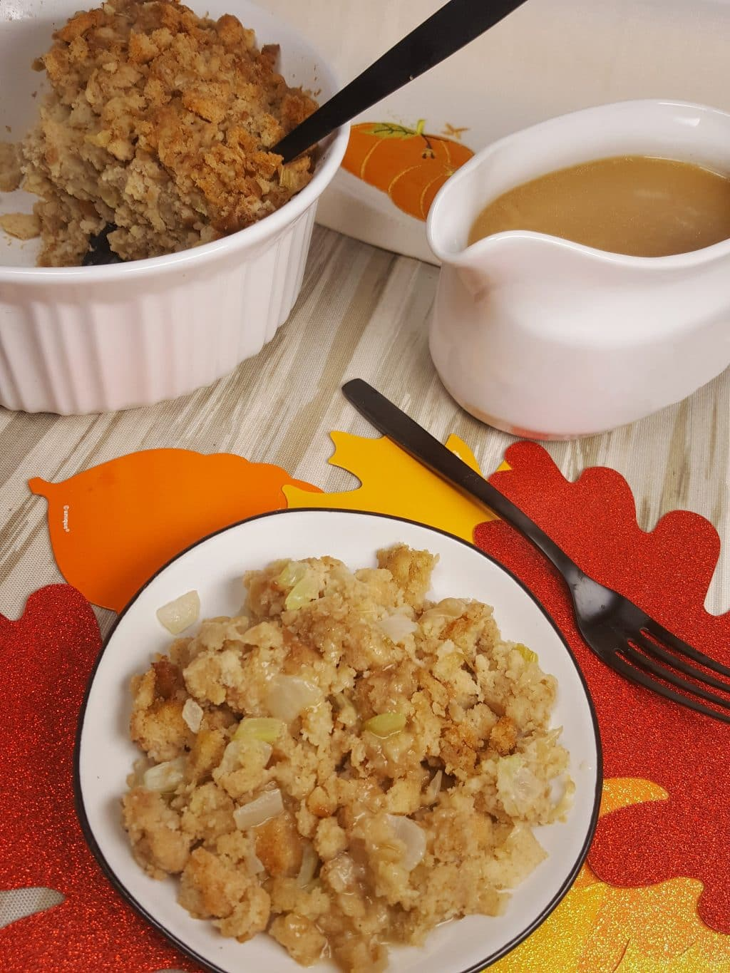 A plate of stuffing cooked in an Instant Pot along with a bowl of turkey gravy.