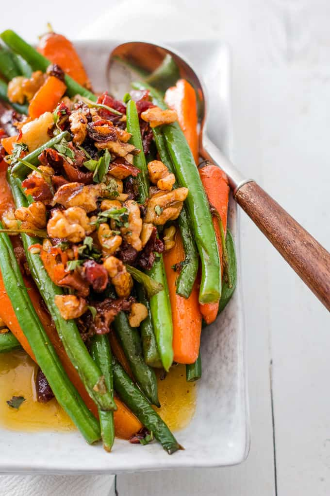 Sauteed Green Beans cooked with carrots and walnuts on a serving platter.
