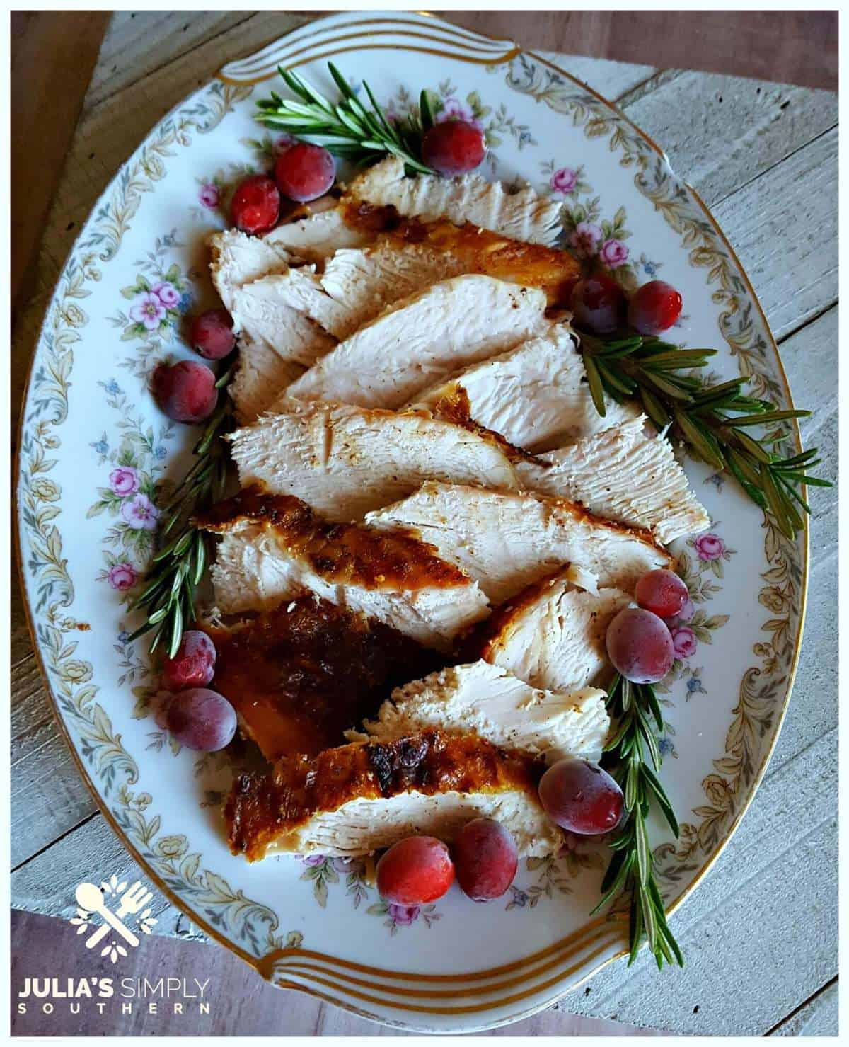 Sliced turkey breast on a plate with flowers.