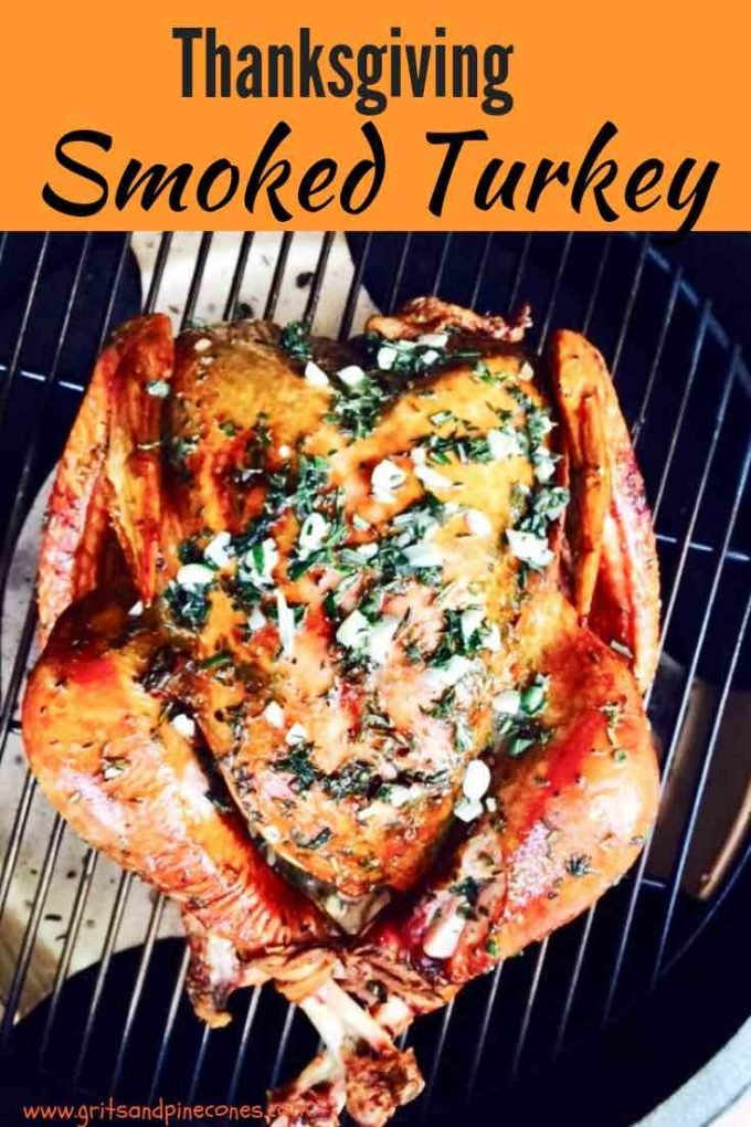 Fresh herbs and garlic come together to produce a tender and juicy smoked turkey for Thanksgiving that is absolutely amazing. Smoking a whole turkey is much easier than you think, and in addition to the smoked turkey recipe, I've included simple instructions for how to dry brine a turkey too!  Smoking gives the turkey a deep golden brown color and the meat is moist and tender. #thanksgiving, #turkeyrecipes, #smoked turkey, #thanksgivingrecipes
