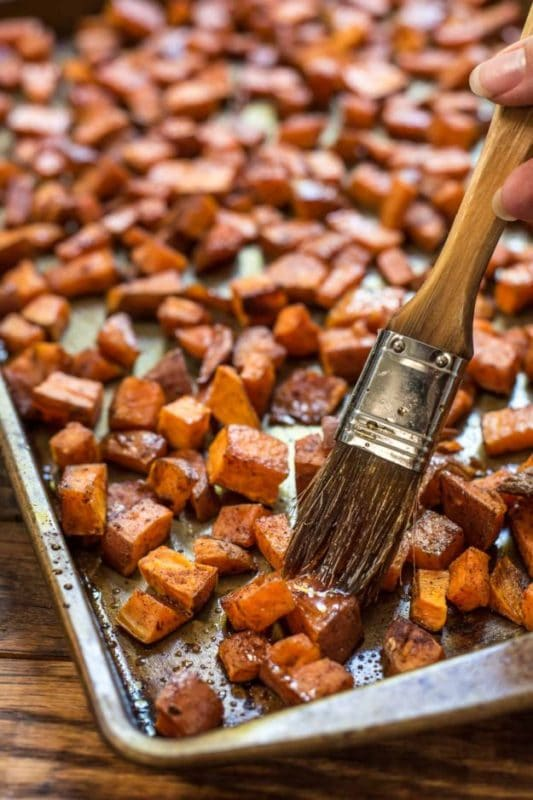 Maple roasted sweet potatoes on a baking sheet.