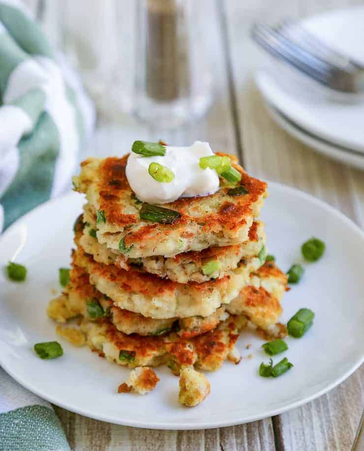 A stack of mashed potato and stuffing cakes.