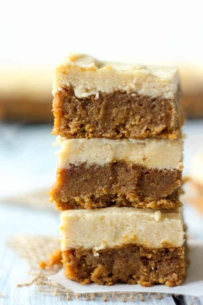 A stack of pumpkin bars with maple frosting.