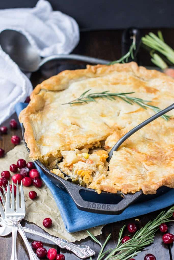 Turkey Pot Pie with a sprig of rosemary.
