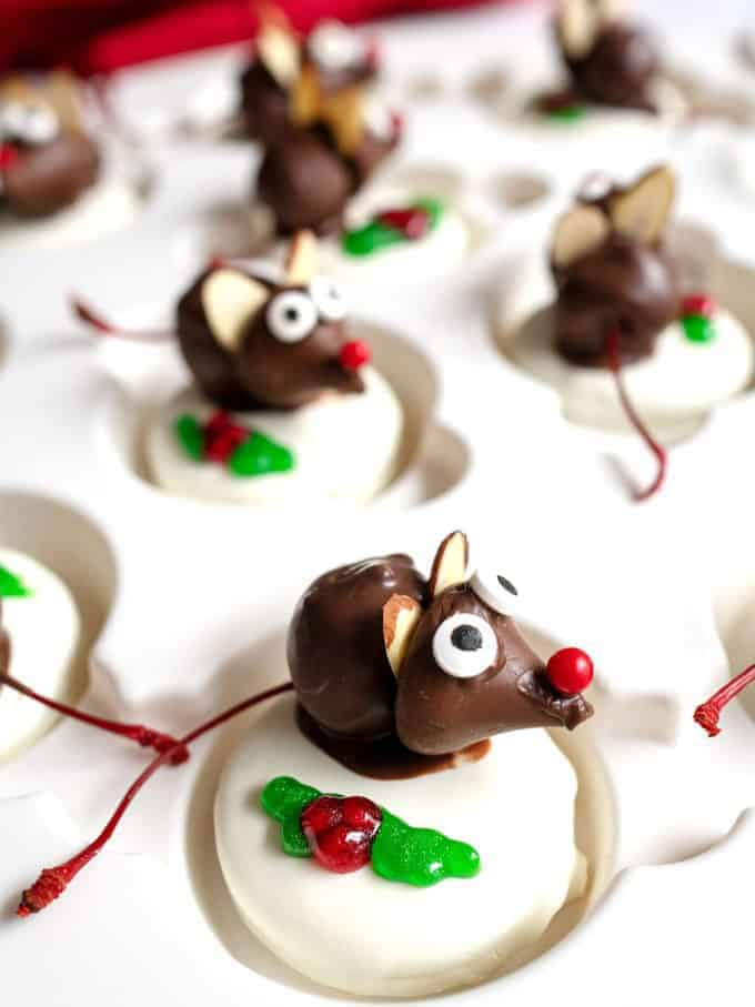 Adorable chocolate Christmas mice made with chocolate covered cherries and white chocolate covered Oreos.