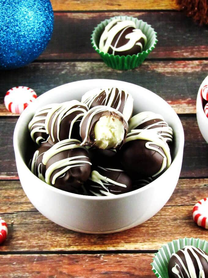 Dark chocolate peppermint truffles in a white bowl.