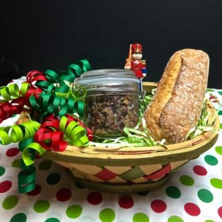 Olive Tapenade in a gift basket with a baguette and ribbons.