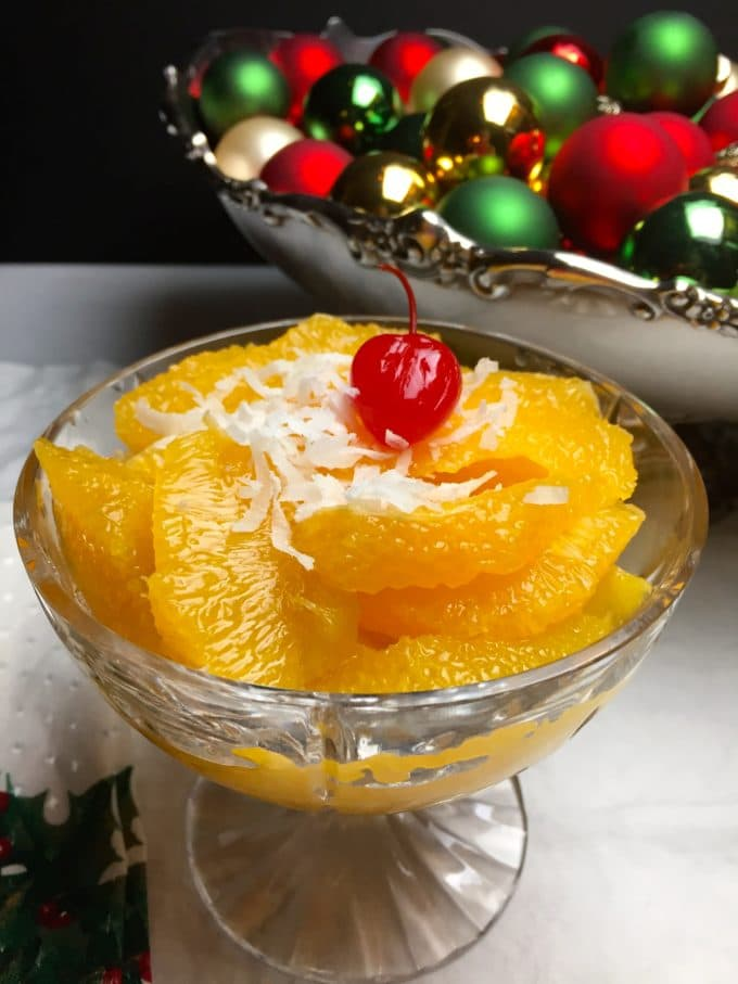 A bowl of Old Fashioned Southern Ambrosia with orange segments and coconut