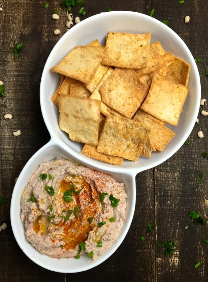 Black Eyed Pea Hummus and crackers in a serving dish.
