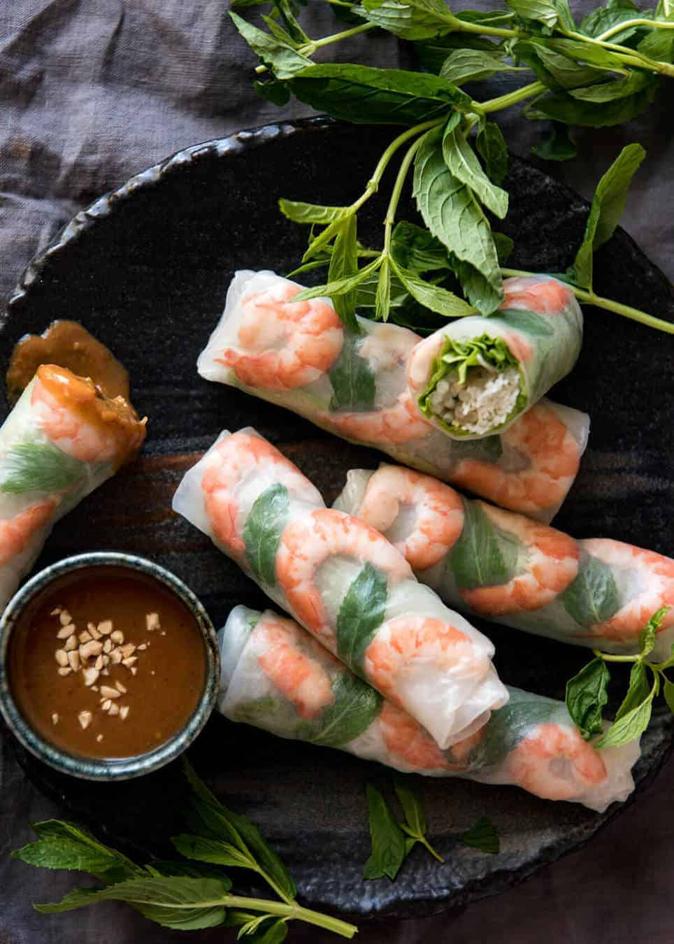 Vietnamese rice paper rolls with shrimp on a serving platter.