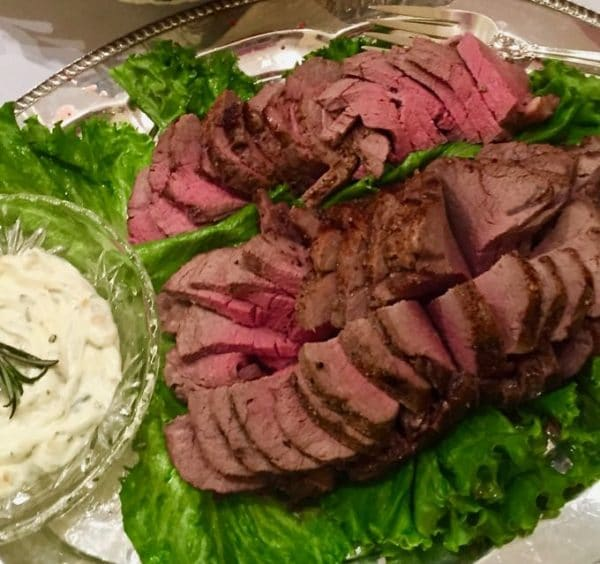 Beef Tenderloin with Gorgonzola Sauce sliced and ready to serve