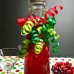 Pinterest pin showing a bottle of cranberry vodka.