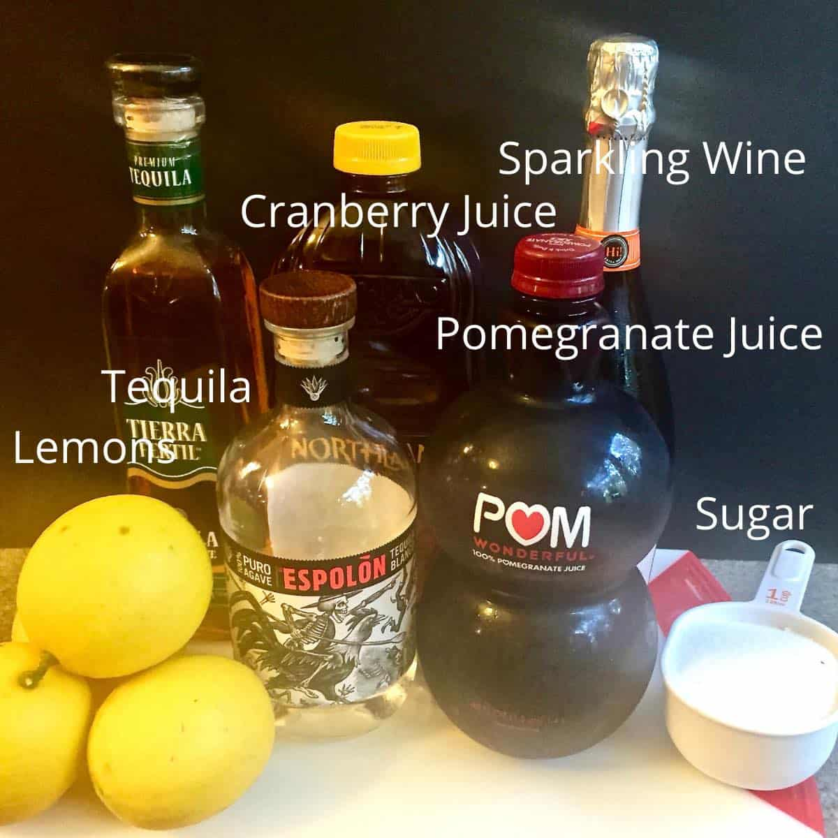 Lemons, tequila, pomegranate juice and other ingredients for punch.