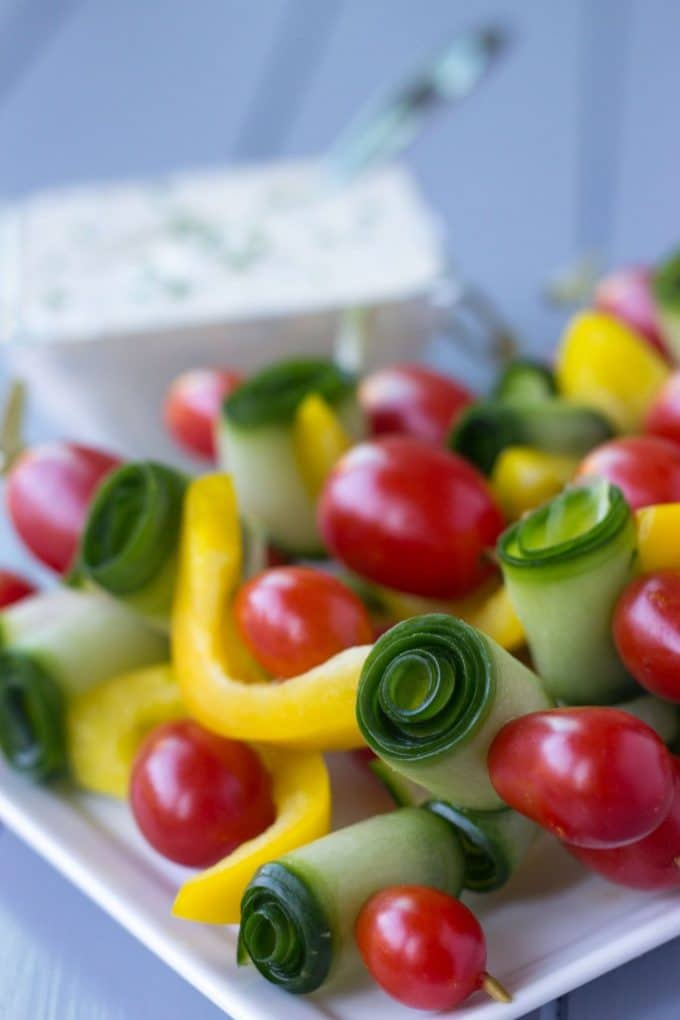 Veggie skewers made with yellow bell pepper, zucchini and cherry tomatoes.