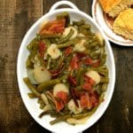 Sweet and Sour Green Beans in a white baking dish with a side of cornbread