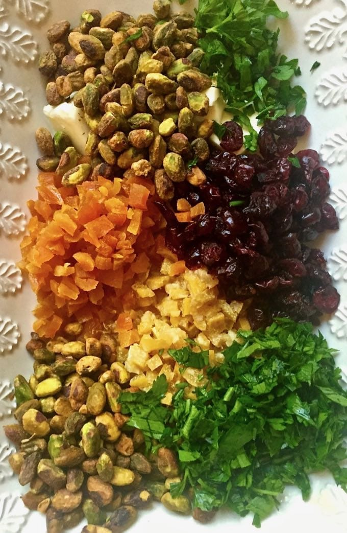 Chopped apricots, cranberries, pistachios, lemon, and parsley for Pearl Couscous with Preserved Lemon