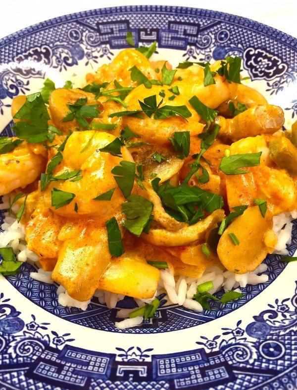 Creamy Shrimp Creole on a blue and white plate.