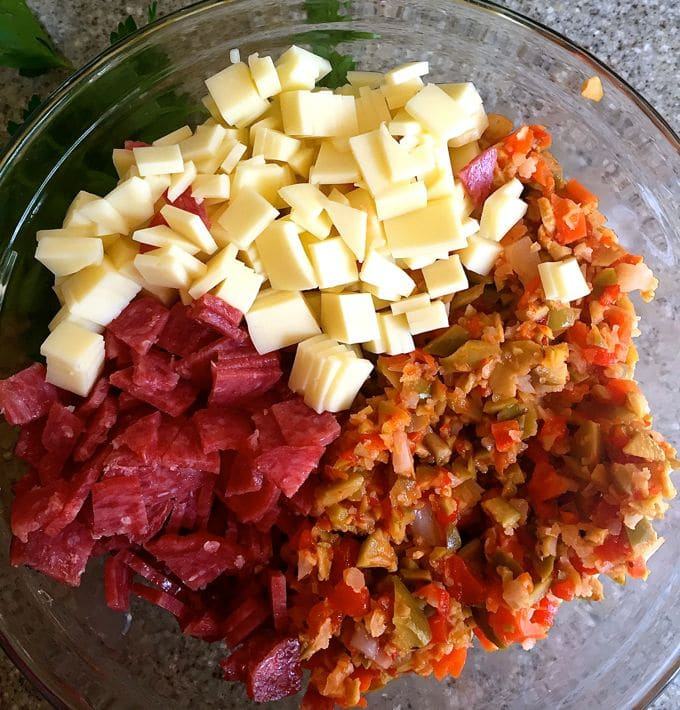 Mixing all of the ingredients in a bowl to make a dip.