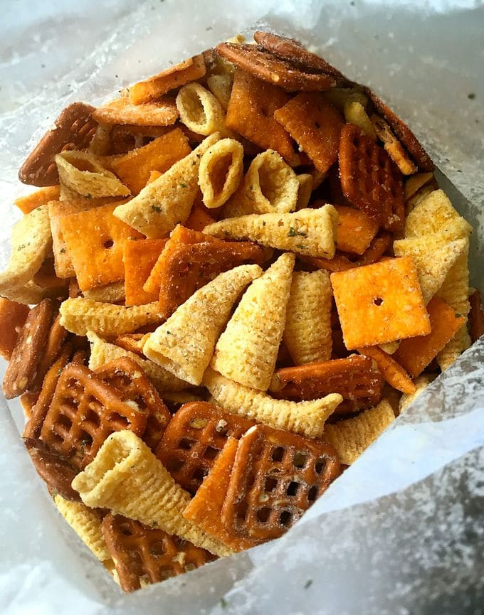 Bugles, pretzels, cheeze-its and nuts in a bag with dry ranch dressing.