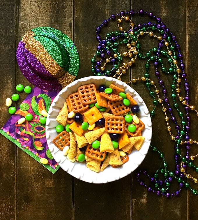 Mardi Gras snack mix with mini pretzels, bugles, and green, purple, and yellow M&Ms.