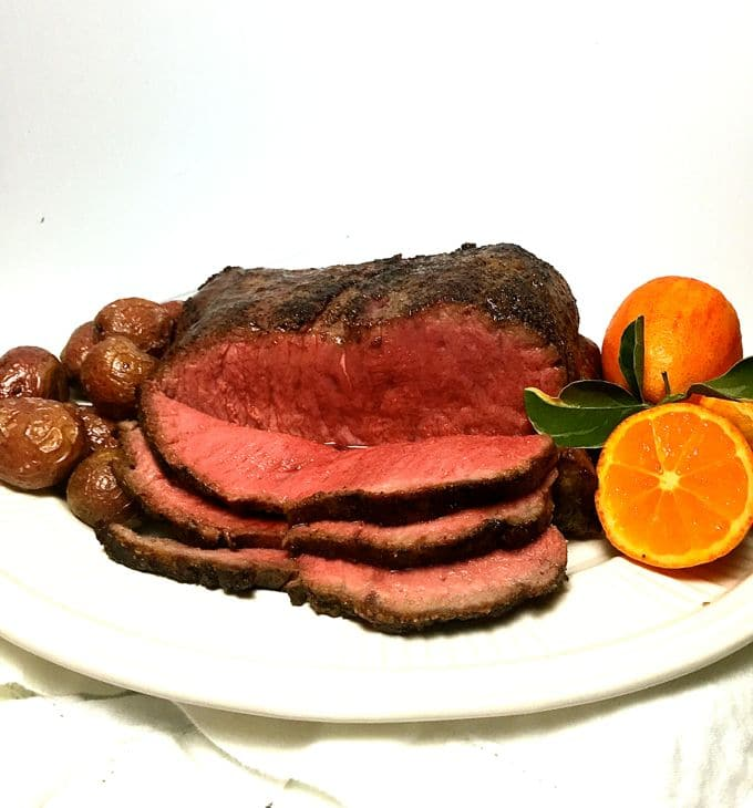 Skillet New York Strip Roast showing rare slices
