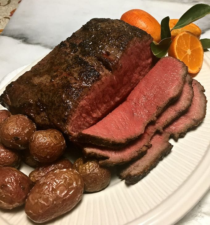 Skillet New York Strip Roast sliced and served rare