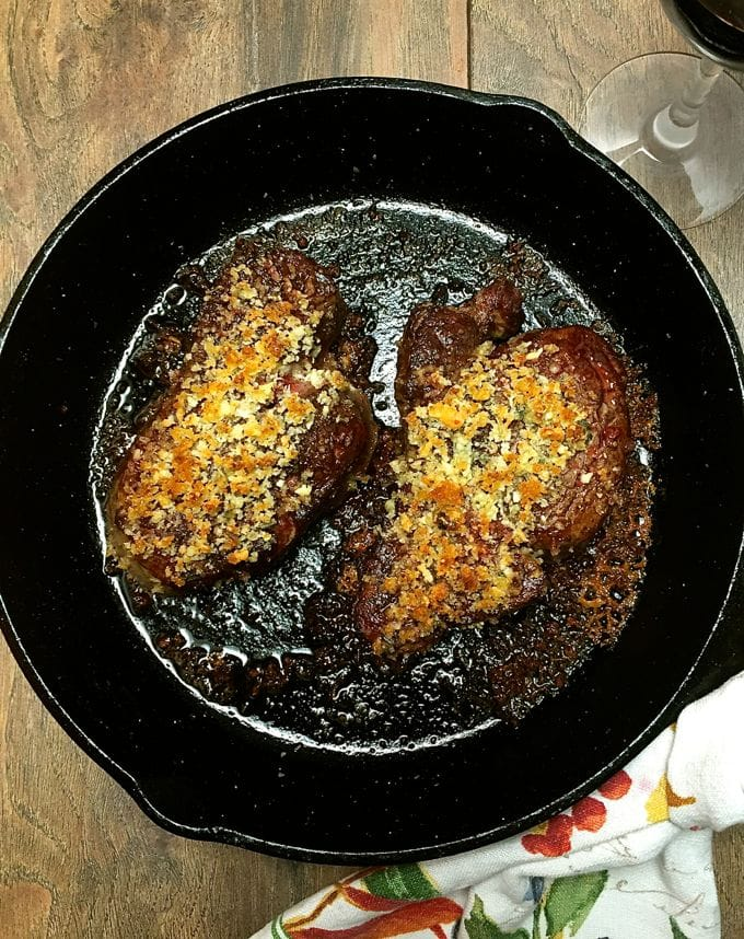 Ultimate Filet Mignon with Blue Cheese Crust ready to serve in a cast iron skillet