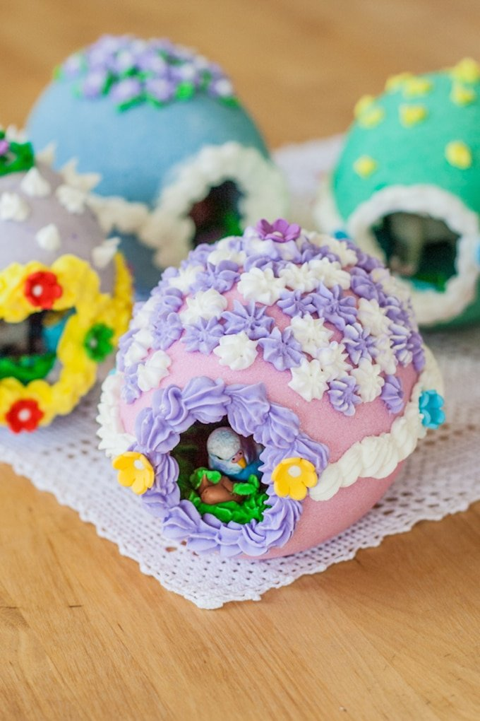 Decorated Easter eggs in different colors filled with candy.