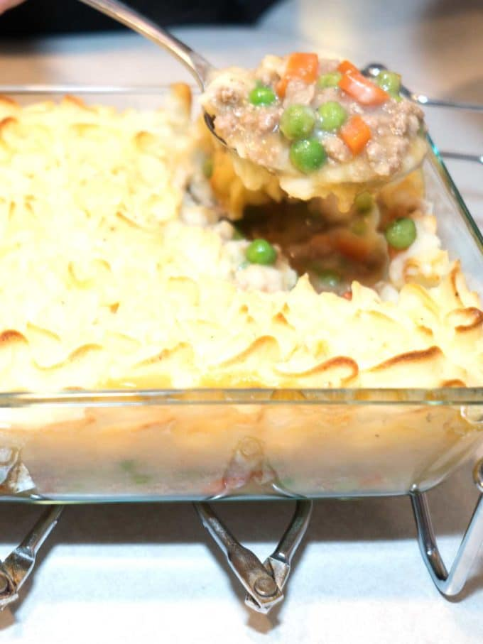 A big serving of of Make Ahead Shepard's Pie in a casserole dish