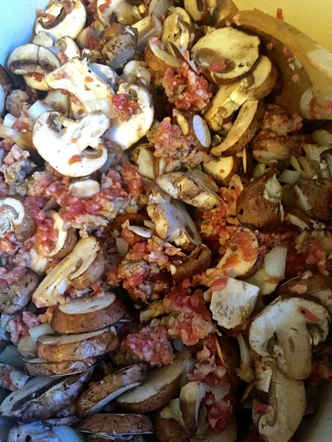 Cooking mushrooms, sausage and onions in a skillet for Easy Baked Spaghetti Pie Casserole