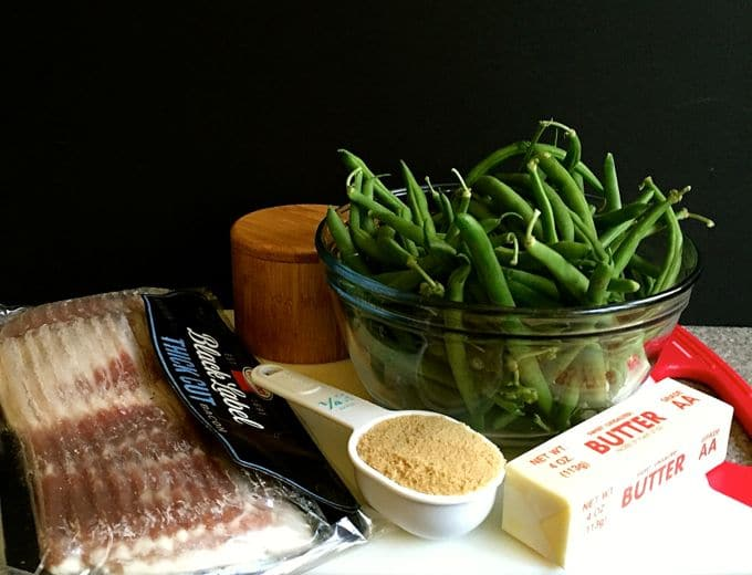 Ingredients for Green Bean Bundles Wrapped in Bacon including green beans, bacon, brown sugar and butter
