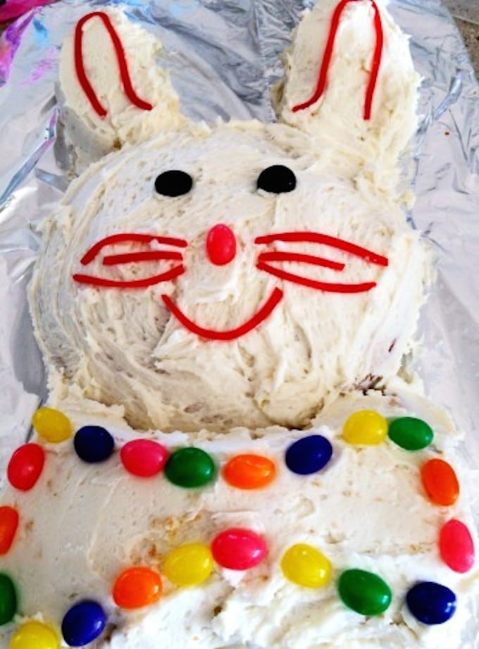 A cake in the shape of an Easter Bunny with jelly beans as decoration.