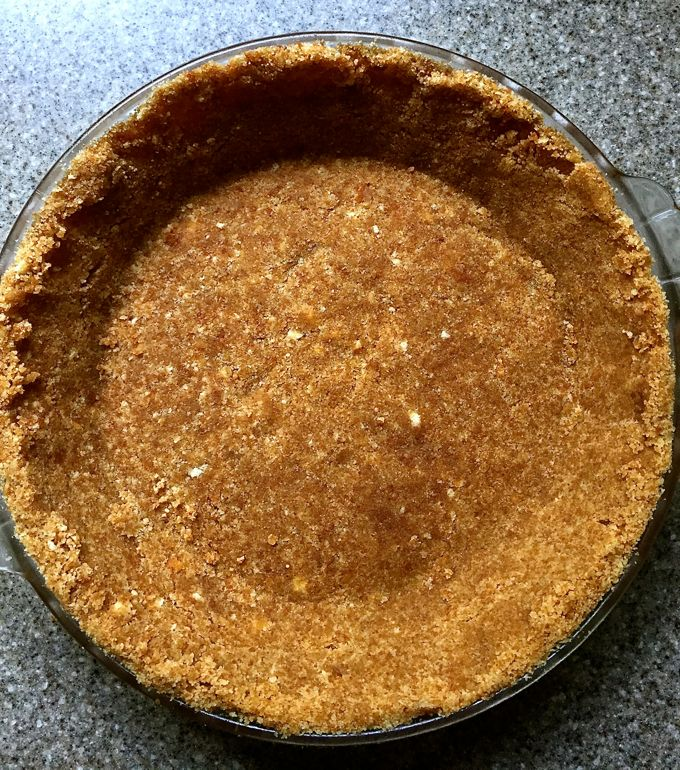 The crumb mixture formed to the nine-inch pie plate.