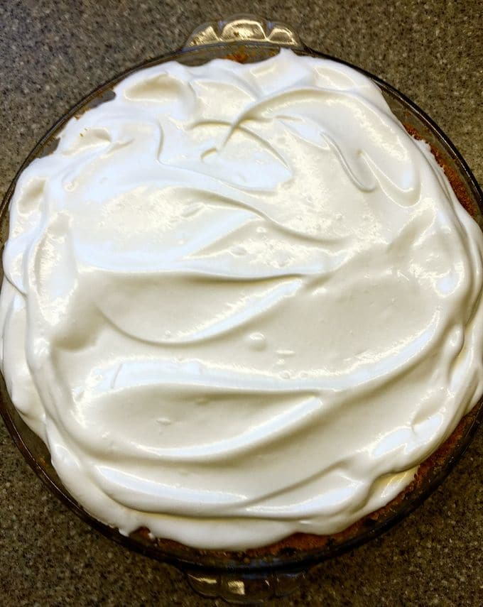 Meringue spread on top of pie.