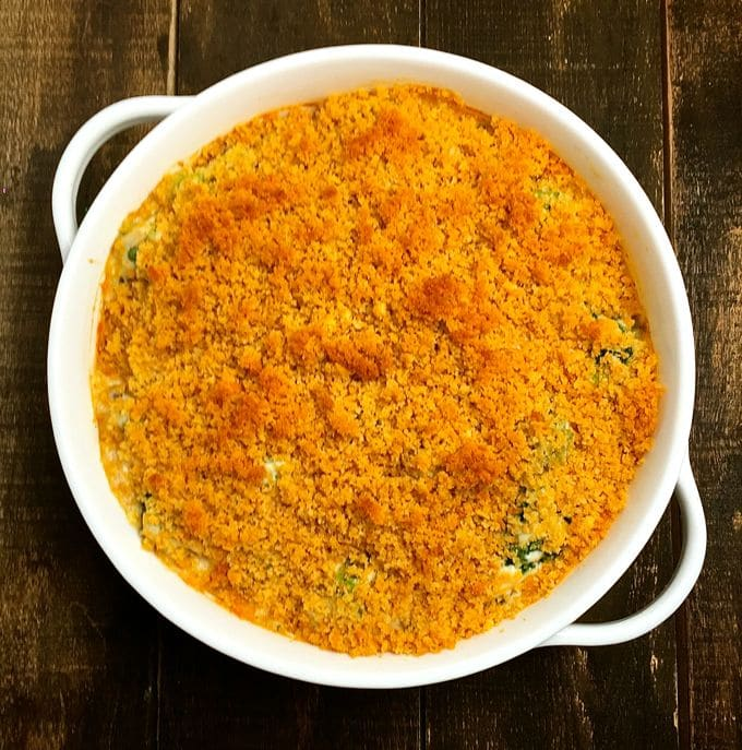 Ultimate Broccoli Cheese Casserole in a baking dish, topped with toasted bread crumbs hot out of the oven