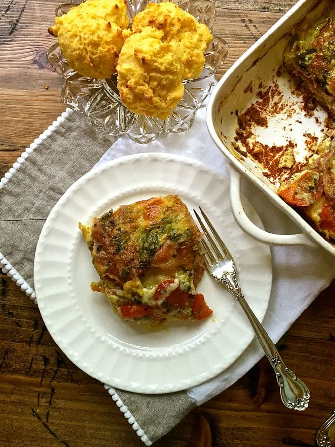 A serving of Prosciutto Breakfast Casserole on a white plate.