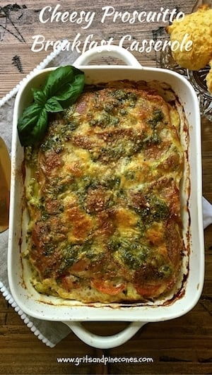 Delicious and make-ahead Cheesy Prosciutto Breakfast Casserole is full of fontina and parmesan cheeses, smoky prosciutto, garlicky pesto and fresh tomatoes.