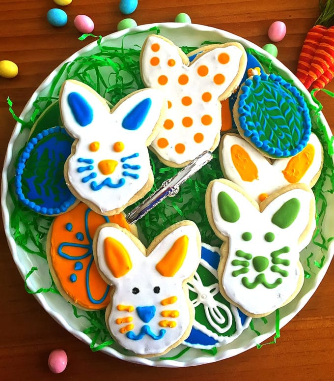 Easter cookies decorated with different colors and in different shapes.
