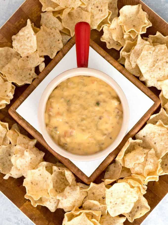 Yummy Spicy Sausage Queso Dip surrounded by chips and ready to eat