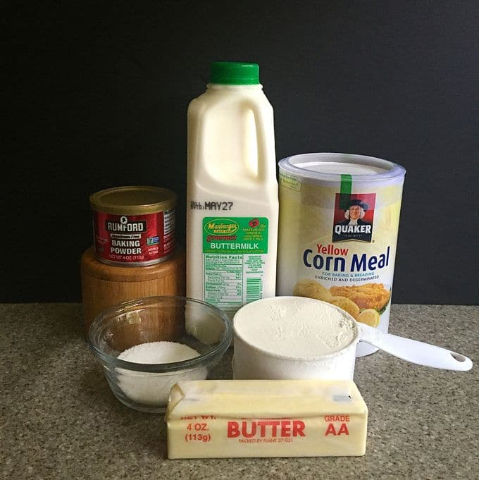 Containers of buttermilk, flour, cornmeal, butter, and baking powder.