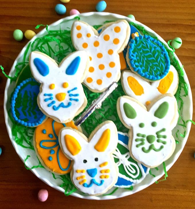 A plate full of decorated Easter egg and bunny rabbit cookies.