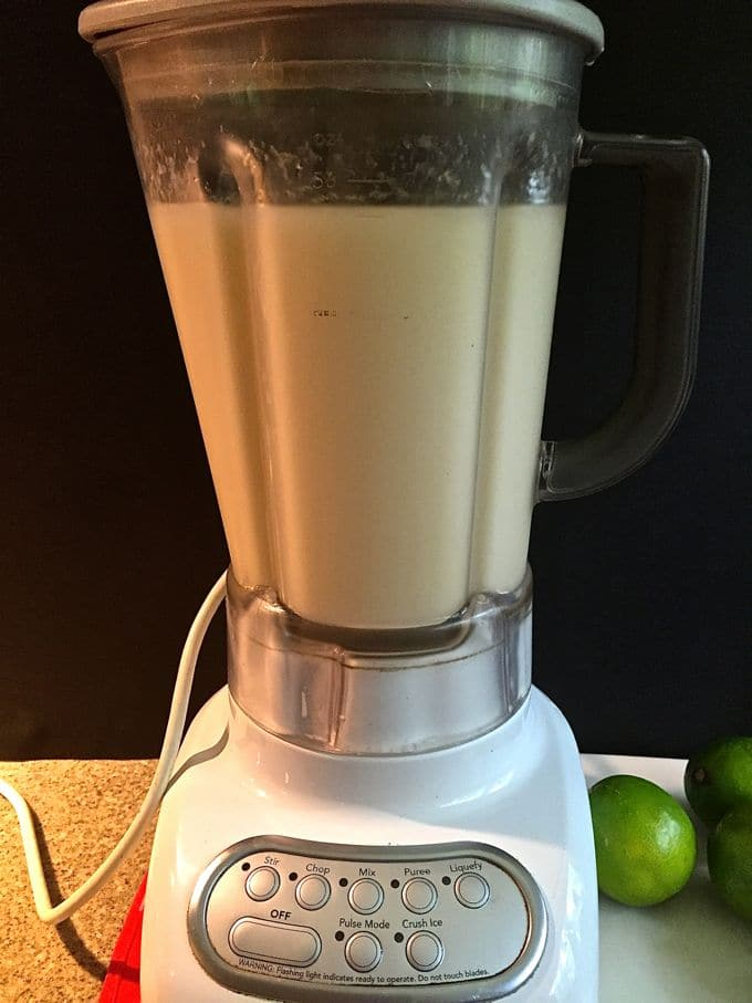 Frozen margaritas in a blender ready to serve.