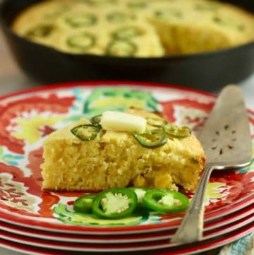 A slice of Mexican jalapeño cornbread. on a colorful plate.