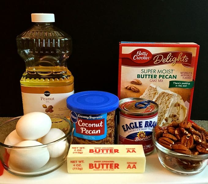 Peanut oil, eggs, cake mix, canned icing, pecans, and sweetened condensed milk. Ingredients to make a cake.