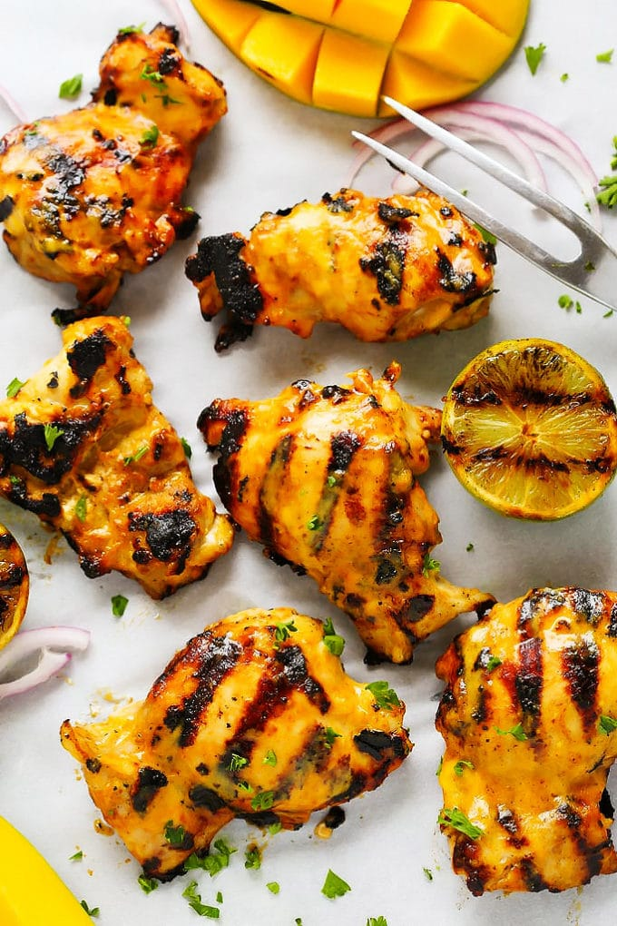 Pieces of Mango Lime Grilled Chicken with grill marks.