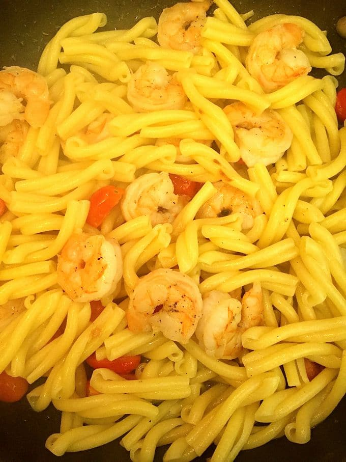 Shrimp and Cherry Tomatoes added to Pesto Pasta with Shrimp and Tomatoes