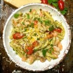 A Bowl of Pesto Pasta with Shrimp and Cherry Tomatoes